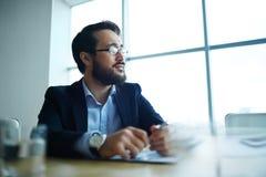 Hombre de negocios pensativo Fotografía de archivo