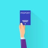 Hombre de negocios plano Hand Hold Travel del icono del pasaporte Fotos de archivo