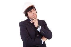 Hombre de negocios por completo de pensamientos Foto de archivo