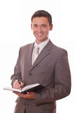 Hombre de negocios positivo con la libreta Foto de archivo libre de regalías