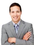 Hombre de negocios positivo con los brazos plegables Foto de archivo