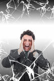 Hombre de negocios preocupado con dolor de cabeza que grita en dolor detrás del brok Imágenes de archivo libres de regalías