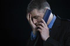 Hombre de negocios preocupante On Telephone Foto de archivo libre de regalías
