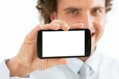 Hombre de negocios Presenting Smart Phone fotos de archivo libres de regalías