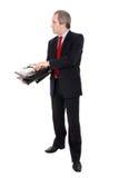 Hombre de negocios que abre una cartera imágenes de archivo libres de regalías