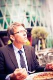 Hombre de negocios que almuerza Imagenes de archivo