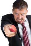 Hombre de negocios que ataca con un cuchillo Imagenes de archivo