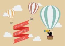 Hombre de negocios que busca negocio en un globo del aire caliente Fotografía de archivo