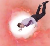 Hombre de negocios que cae abajo con el fondo abstracto Fotos de archivo libres de regalías