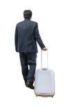 Hombre de negocios que camina con la carretilla y el bolso Fotos de archivo