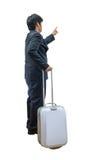 Hombre de negocios que camina con la carretilla y el bolso Imagen de archivo
