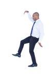 Hombre de negocios que camina con los brazos para arriba Imagenes de archivo
