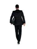 Hombre de negocios que camina detrás Fotografía de archivo