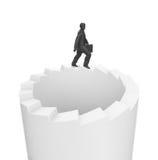 Hombre de negocios que camina en las escaleras sin fin Imagen de archivo