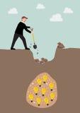 Hombre de negocios que cava una tierra para encontrar una idea Imagen de archivo libre de regalías