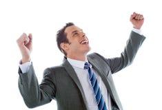 Hombre de negocios que celebra éxito con los brazos para arriba Fotos de archivo libres de regalías