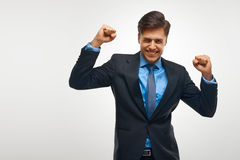 Hombre de negocios que celebra éxito contra el fondo blanco Fotografía de archivo