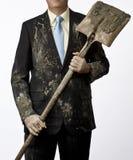 Hombre de negocios que consigue sucio Imagen de archivo libre de regalías