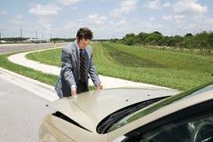 Hombre de negocios Checking Under Hoo Fotos de archivo libres de regalías