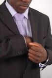 Hombre de negocios que controla el bolsillo para saber si hay una pluma Imagen de archivo