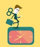 Hombre de negocios que corre en el reloj Imágenes de archivo libres de regalías