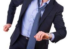 Hombre de negocios que corre tarde. Fotos de archivo