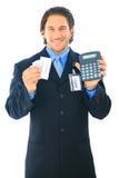 Hombre de negocios que cuenta la calculadora del dinero Foto de archivo libre de regalías