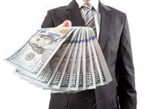 Hombre de negocios que da el dinero Fotografía de archivo