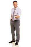 Hombre de negocios que da el teléfono elegante Foto de archivo libre de regalías