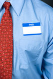 Hombre de negocios que desgasta el nametag en blanco Foto de archivo libre de regalías