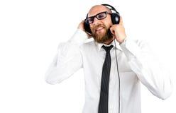 Hombre de negocios que disfruta de música Fotografía de archivo libre de regalías