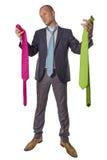 Hombre de negocios que elige el lazo aislado en el fondo blanco Foto de archivo libre de regalías