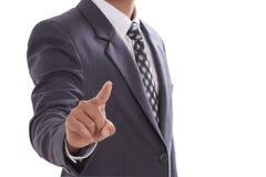 Hombre de negocios que empuja la pantalla manualmente Foto de archivo libre de regalías