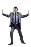 Hombre de negocios que empuja lejos obstáculos virtuales Imágenes de archivo libres de regalías