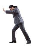 Hombre de negocios que empuja obstáculos virtuales Imagen de archivo libre de regalías