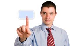 Hombre de negocios que empuja un botón Foto de archivo