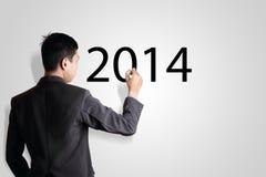 Hombre de negocios que escribe el año 2014 Imagen de archivo libre de regalías