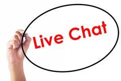 Hombre de negocios que escribe la palabra de Live Chat con la pluma Imágenes de archivo libres de regalías