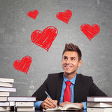 Hombre de negocios que escribe una letra de amor Imagen de archivo