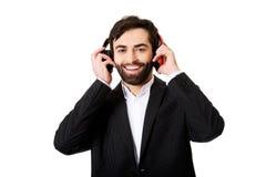 Hombre de negocios que escucha la música Imágenes de archivo libres de regalías