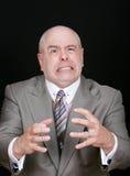 Hombre de negocios que estrangula algo Fotografía de archivo