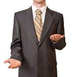Hombre de negocios que gesticula con vacío arriba y abajo de las manos Imagen de archivo