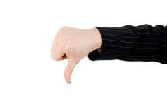 Hombre de negocios que gesticula el pulgar abajo. Imagen de archivo libre de regalías