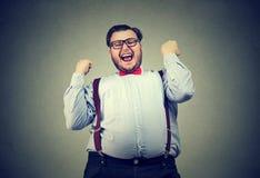 Hombre de negocios que grita con felicidad fotografía de archivo libre de regalías