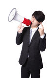 Hombre de negocios que grita en alta voz en un megáfono Foto de archivo
