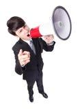 Hombre de negocios que grita en alta voz en un megáfono Imágenes de archivo libres de regalías