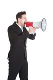 Hombre de negocios que grita en el megáfono Imagen de archivo