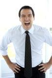 Hombre de negocios que grita en la cámara Fotos de archivo libres de regalías