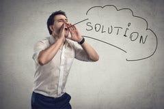 Hombre de negocios que grita para la solución Fotografía de archivo libre de regalías