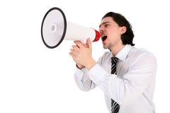 Hombre de negocios que grita a través del megáfono Imagen de archivo